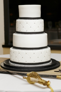 White wedding cake with black trim.